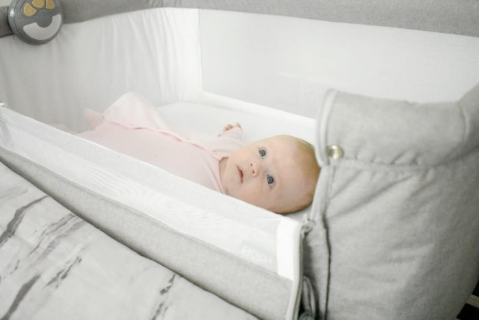 This image has an empty alt attribute; its file name is Baby-in-the-nuby-sleep-next-to-me-crib-700x467.jpg