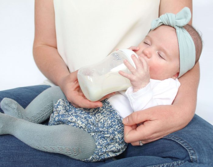 This image has an empty alt attribute; its file name is Baby-being-bottle-fed_cover-shot-700x549.jpg